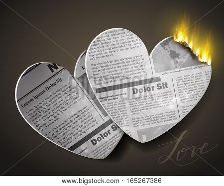 burning two newspaper hears for Valentines day with fire