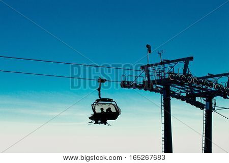 Chopok, Slovakia - January 12, 2017: Chair Ski Lift With Skiers Over Blue Sky In The Evening, Januar