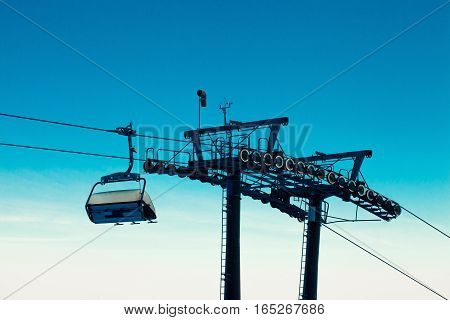Empty Chair Ski Lift Over Blue Sky In The Evening