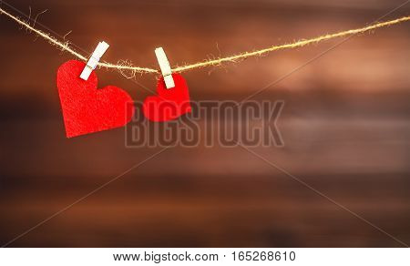 background Valentine's day. two red hearts on a wooden background