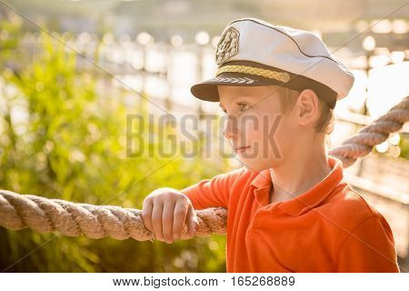 Beautiful boy is about rope in the captain's cap