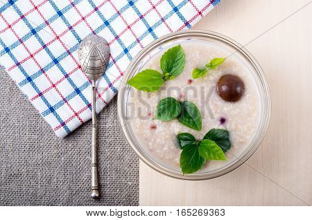 Oatmeal With Chocolate Candy And A Silver Spoon