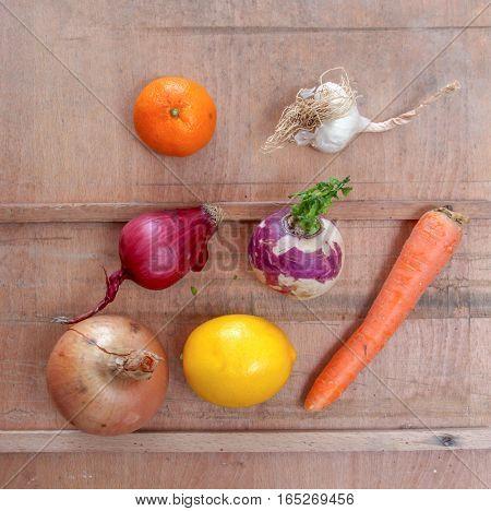 various vegetbles and citruses. radishonion carot lemonorangeaniongarlic