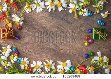 Christmas and new year wooden background banner with with gift box daisy flower candy balls.decoration on vintage background.