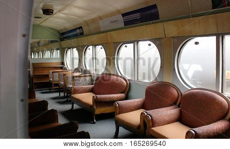 Bulawayo, Zimbabwe - 05 April, 2015: Inside of still being operational retro carriage of a train on the platform at the Bulawayo`s railway station Zimbabwe. The legacy of British empire. Southern Rhodesia (renamed Zimbabwe in 1980) was a British colony.