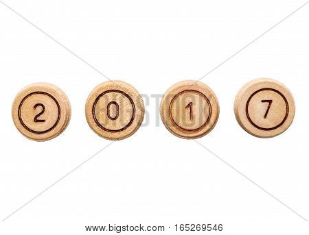 2017 text from small wooden barells. Isolated on white.