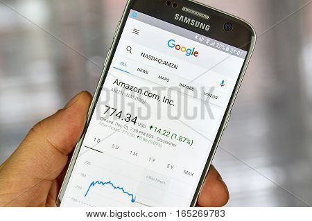 MONTREAL CANADA - DECEMBER 23 2016 : Google Finance page with stock chart and Amazon ticker on Samsung S7 screen.