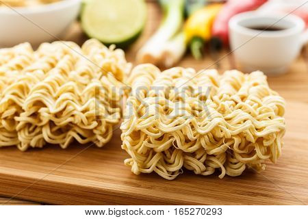 Asian instant noodles on a wooden board.