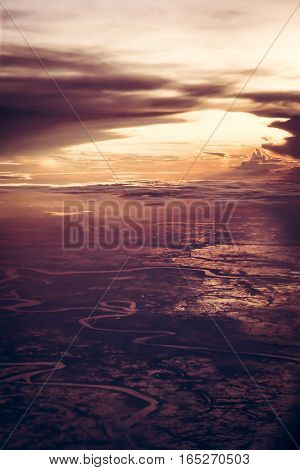 Dramatic sunset over the earth from the height in vintage style with epic sky