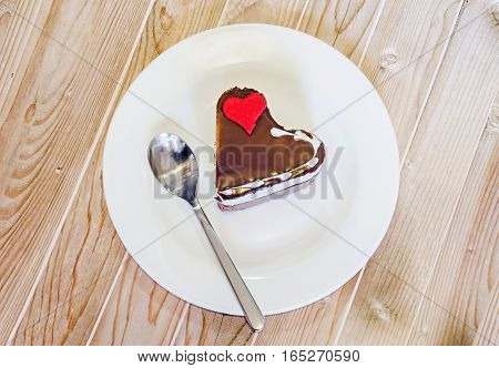 Heart Shape Chocolate Cake With Sugare Red Heart On White Plate, Close Up, Isolated.