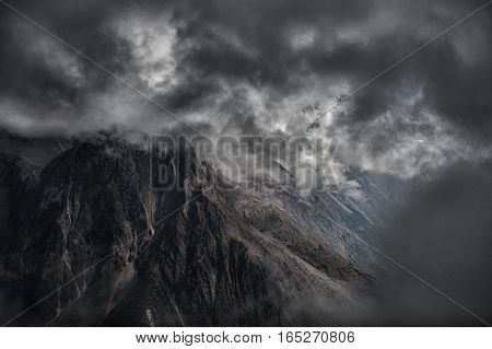 High mountains in clouds - rocky background. Nepal, Manaslu