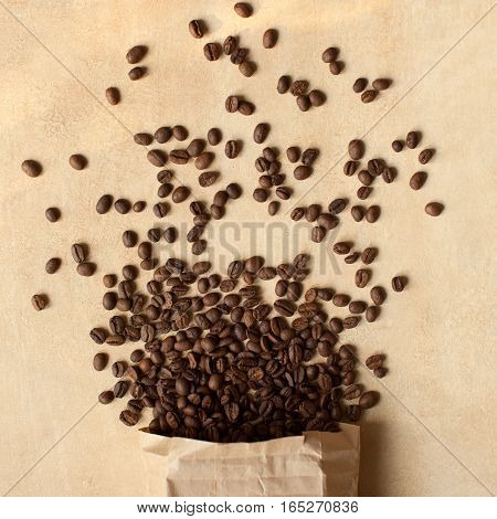 Scattered coffee beans. Brown coffee background. Top view