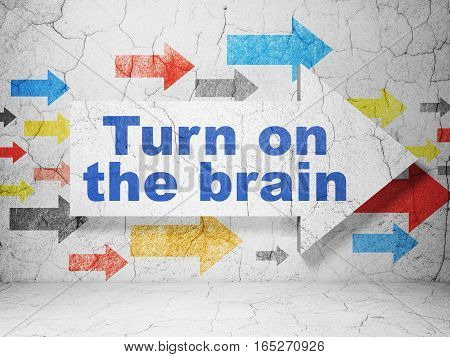 Education concept:  arrow with Turn On The Brain on grunge textured concrete wall background, 3D rendering