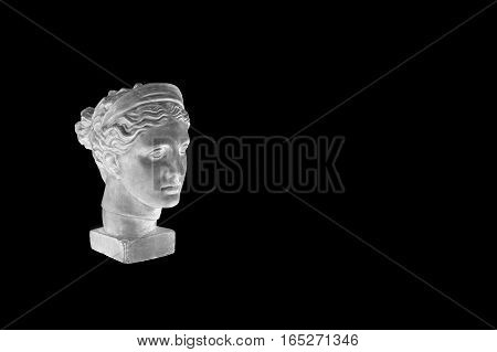 Marble head of young woman, ancient Greek goddess bust isolated on black background with copy space for text