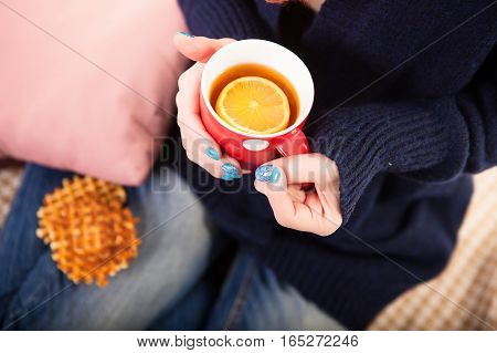 Holding Coffee Latte Cup with Cocoa Shape and Cozy Wool Hands Warmers on Magic Winter Background.