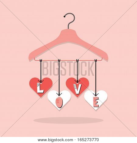 Cute pink hanging LOVE paper cut heart tags with clothing hanger on pink background