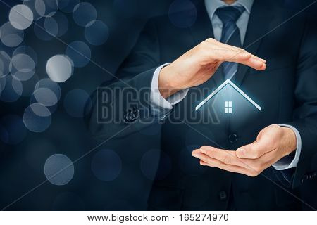 Real estate agent offer house. Property insurance and security concept. Right composition with bokeh in background.