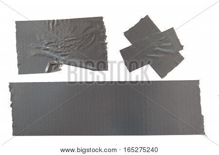 Set of used gray duct tape pieces