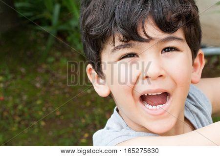Boy Smiles Happily
