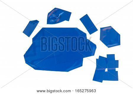 Collection of used blue electrical tape pieces