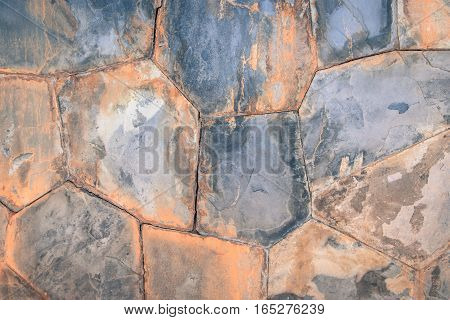 Rough stone marble brick wall background texture on vintage style