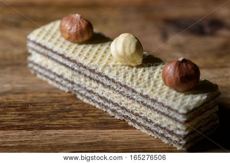 wafers filled with hazelnut cream and hazelnuts above