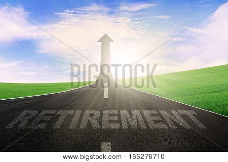 Image of empty highway with word of retirement and arrow upward at the end of a road