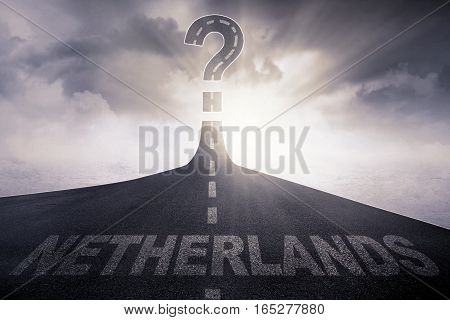 Empty road with word of a Netherlands and question mark at the end of a road