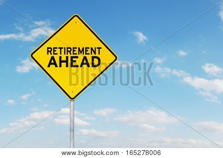 Picture of yellow sign board with a text of retirement ahead under clear sky
