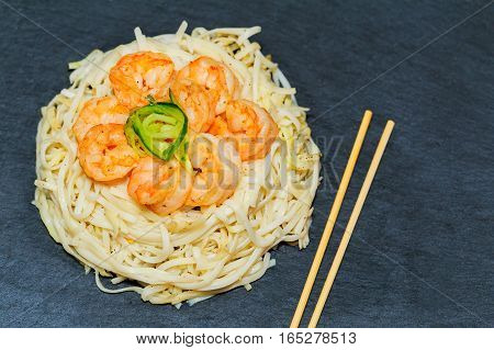 Delicious Rice Noodles With Shrimp And Vegetables Macro On A Plate.