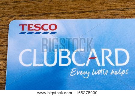 LONDON UK - JANUARY 13TH 2017: A close-up of a Tesco Clubcard pictured on a wooden surface on 13th January 2017.