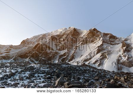 Sunrise over white snow mountains peak panorama. Nepal, Manaslu