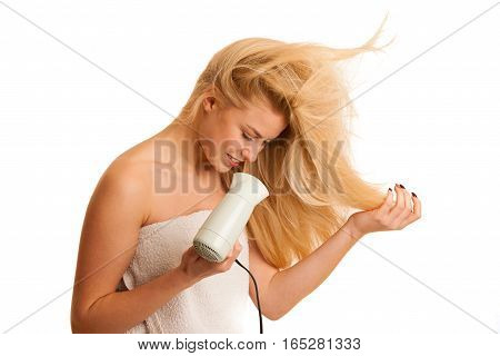 Blonde Woman Drieing Her Hair With Air Blower Isolated Over White