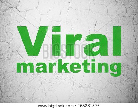 Advertising concept: Green Viral Marketing on textured concrete wall background