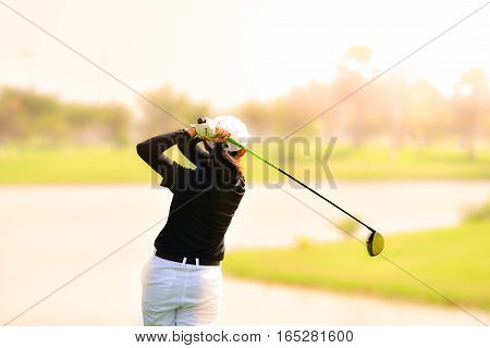 Golfer hitting golf shot on summer vacation concept go to success.