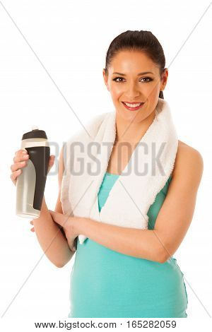 Woman Rests After Fitness Workout With Towel Around Her Neck Drinking Water Isolated Over White Back
