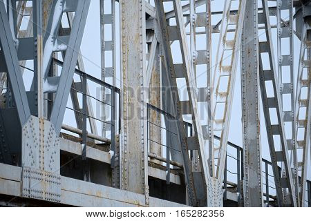 Support above the old bridge steel structure close-up