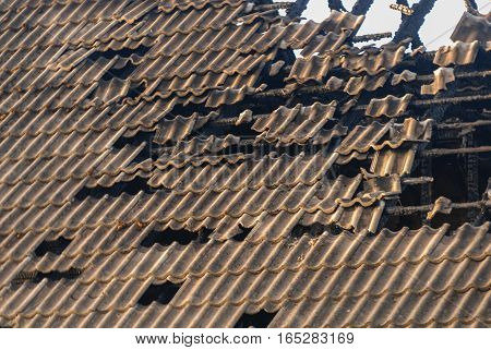 textured broken roof of the burned house