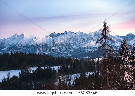 Winter landscape of High Tatra Mountains on the Slovak-Polish border at dusk