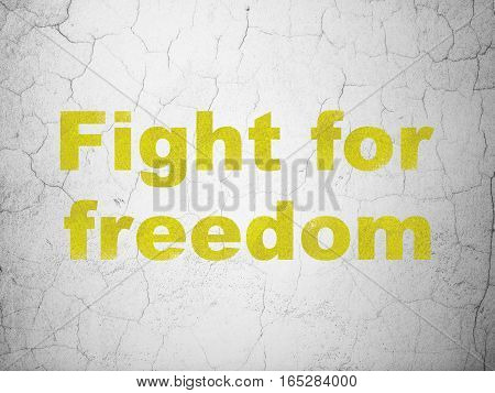 Political concept: Yellow Fight For Freedom on textured concrete wall background