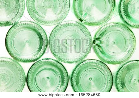 Close-up picture of bottoms of empty glass bottles isolated on white