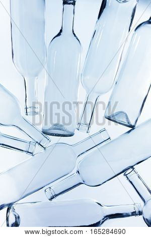 A large heap of empty glass wine bottles without labels