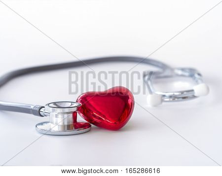 Red Heart And Stethoscope On White Background. Health Care Concept.