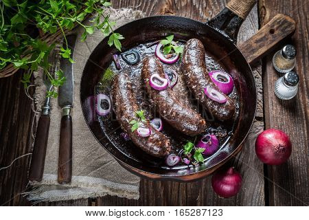 Hot Black Pudding With Parsley And Onion On Pan