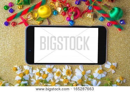 Christmas and new year wooden background banner with blank smart phone gift box daisy flower candy ball and decoration on gold paper vintage background.