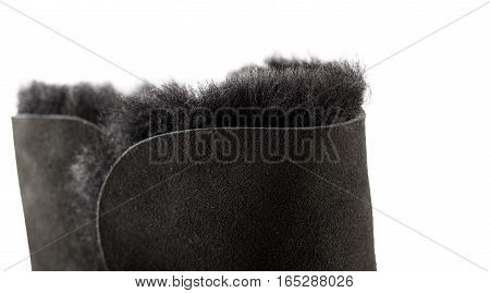 Closeup of a black UGG boot isolated on white