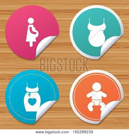 Round stickers or website banners. Maternity icons. Baby infant, pregnancy and shirt signs. Dress with heart symbol. Circle badges with bended corner. Vector