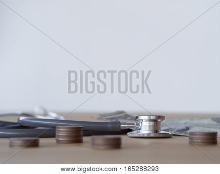 Stethoscope And Money On A Wooden Table. Money For Health Care, Concept.