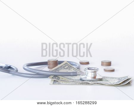Stethoscope And Money On White Background. Money For Health Care, Concept.