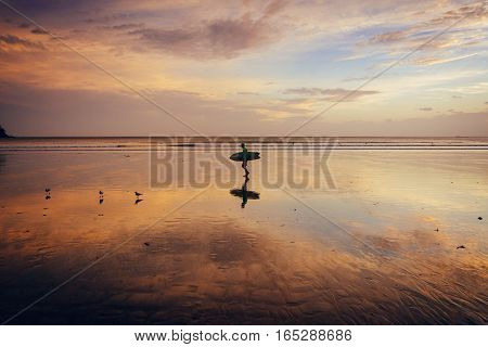 Beautiful sunset on the beach at low tide and reflections in the sand